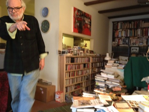Irby at home in Lawrence, trying to point me toward a CD we wanted to listen to — November 2011.