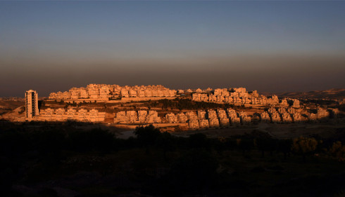 The Jewish settlement of Har Homa at sunset in east Jerusalem on June 3, 2009. (AHMAD GHARABLI/AFP/Getty Images) #